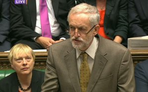 Angela Eagle MP looks up at Jeremy Corbyn during PMQs